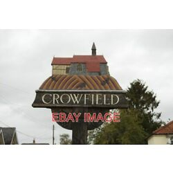 PHOTO  CROWFIELD VILLAGE SIGN UNVEILED BY THE LATE ROY HUDD OBE. IN FEBRUARY 201