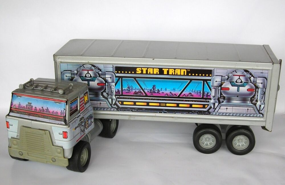 18 Toy Trucks : Ertl steel truck star tran wheeler robot space toy semi