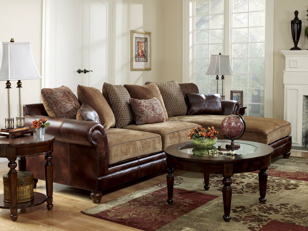 living room with leather couch sanders world faux leather amp chenille sofa 22399