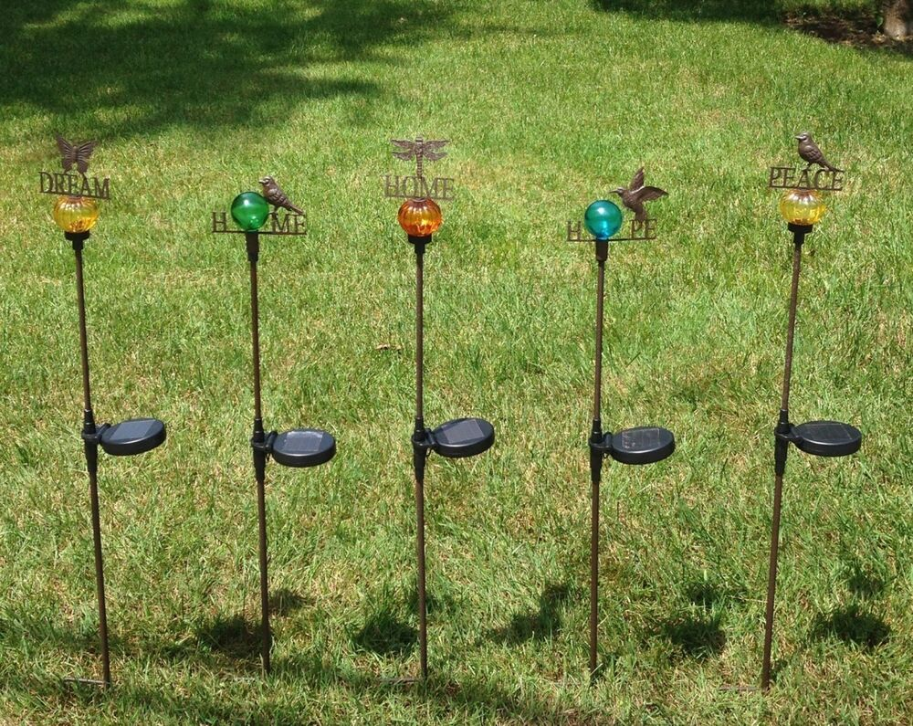 Solar powered decorative lights garden stakes choose home for Decorative garden stakes