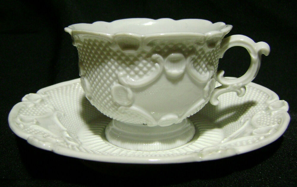 german porcelain cabinet cup and saucer white releif work ...