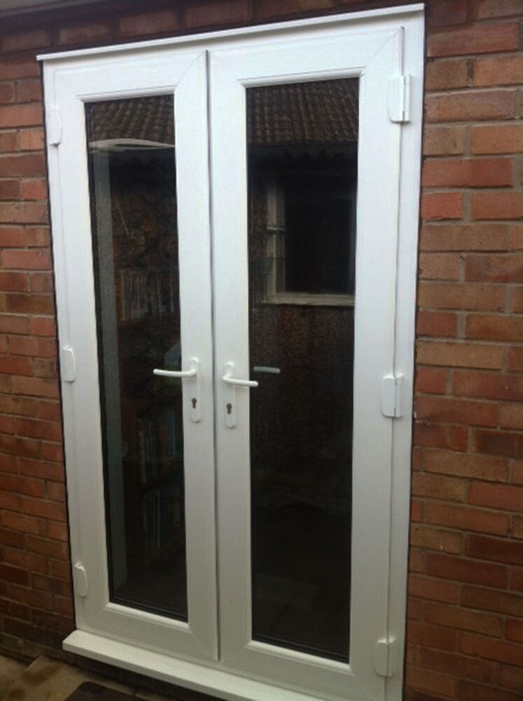 White 1200mm upvc patio doors open out ebay for Upvc french doors inward opening