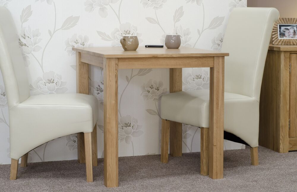 urbana solid oak furniture square dining table and two