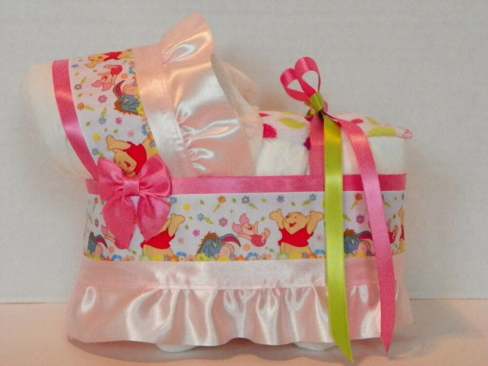 Winnie the pooh girl diaper bassinet baby shower table for Baby shower diaper decoration
