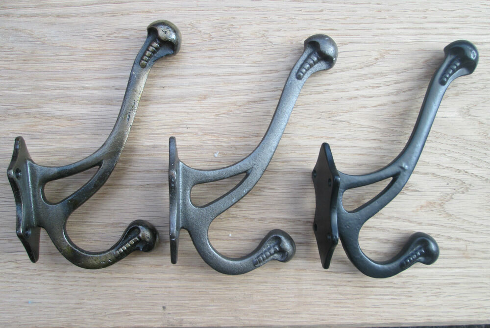 Cast iron vintage decorative fancy old style hat and for Picture hanging pegs