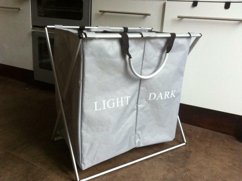 Clearly marked dual hampers make it easy to organize both light and dark clothes. Mesh top bag with drawstrings allow you to quickly secure and tote your laundry. Heavy duty polyester exterior for .