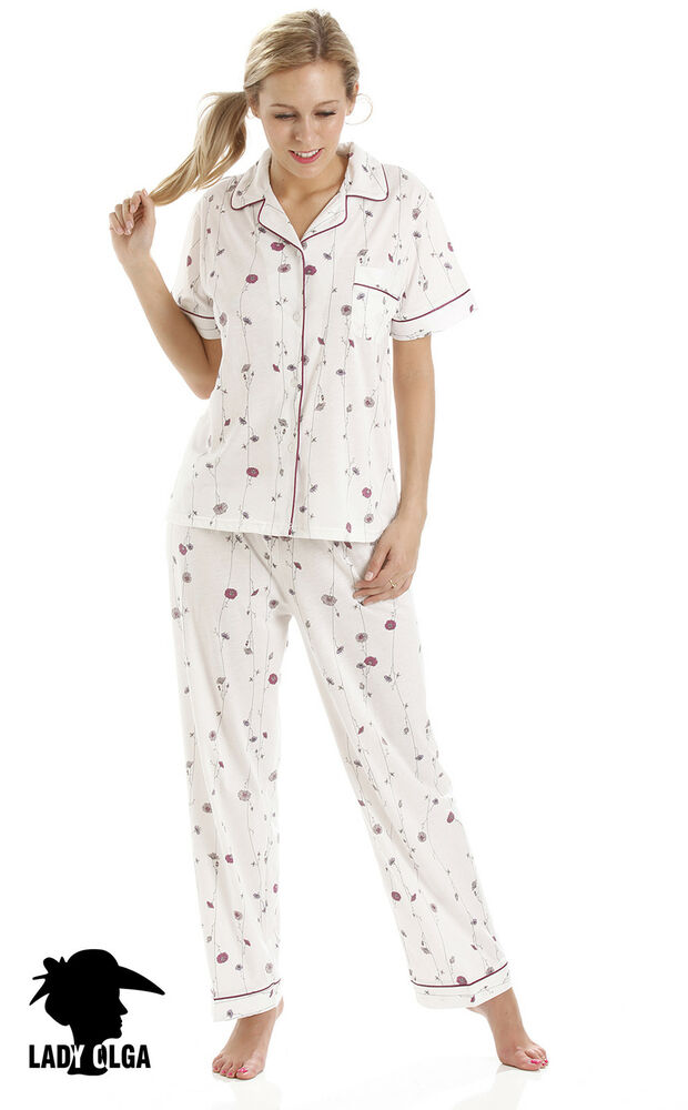 These PJs are impossibly cute, made with a short-sleeve, pink top and capri-length print pants in super-soft cotton jersey. The top features a scoop V-neck, curved hem and breast pocket that matches the capri's flamingo print pattern.