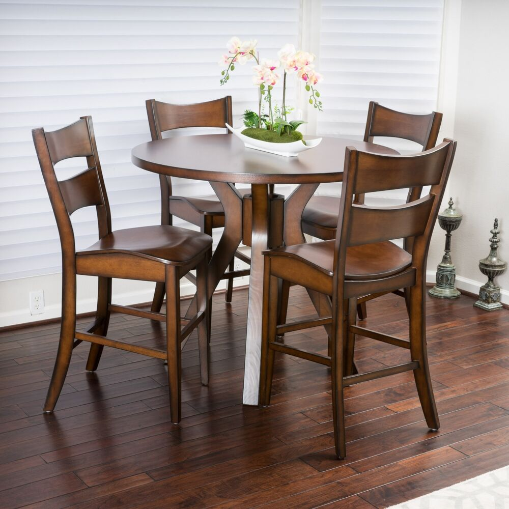 Casual 5 piece round counter height brown wood dining set for Round dining table set