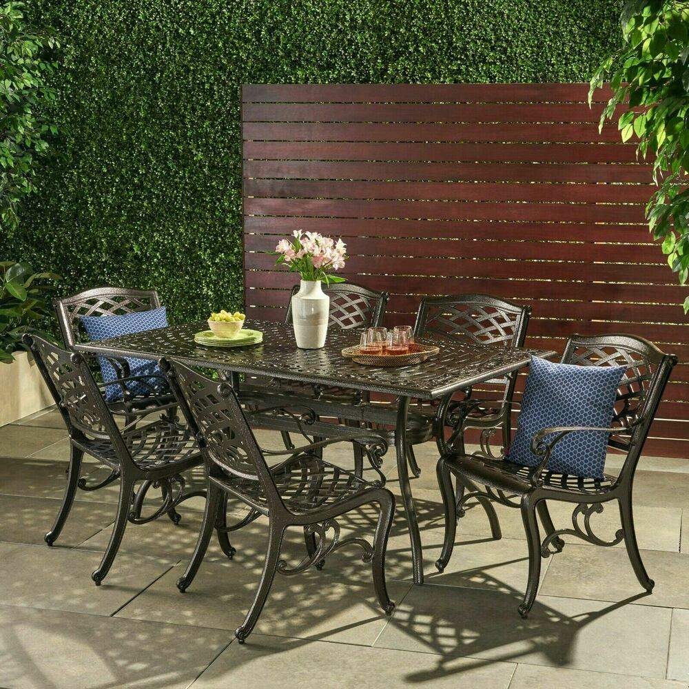 outdoor 7 piece cast aluminum rectangle bronze dining set. Black Bedroom Furniture Sets. Home Design Ideas