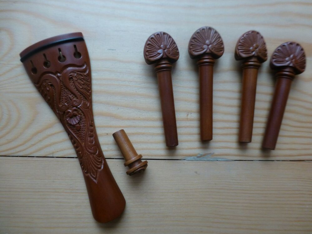 Violin fittings luxuriously carved pegs tailpiece and