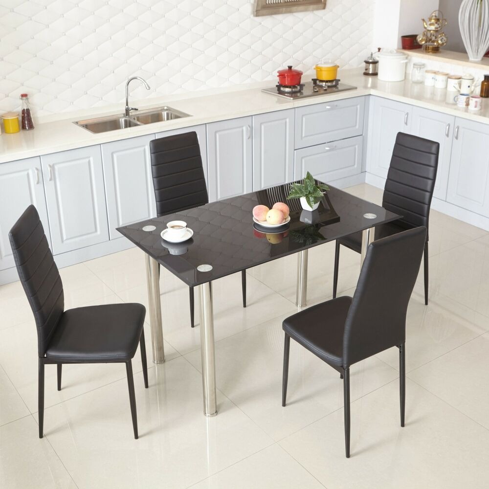 Black glass dining table and 4 faux leather chairs for Leather kitchen table chairs