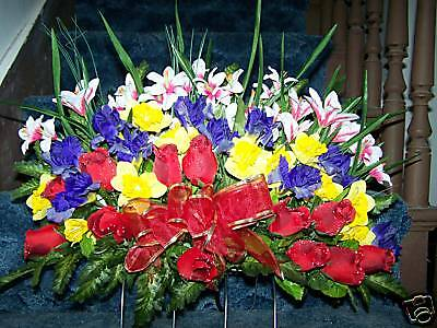 Grave cemetery tombstone saddle flowers lilies roses daffodil solar