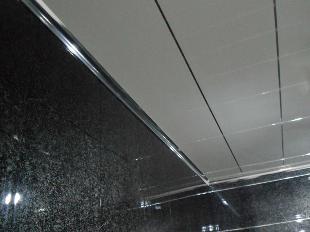 High Gloss Wall Paneling : High gloss white wall panels with chrome strip edge for