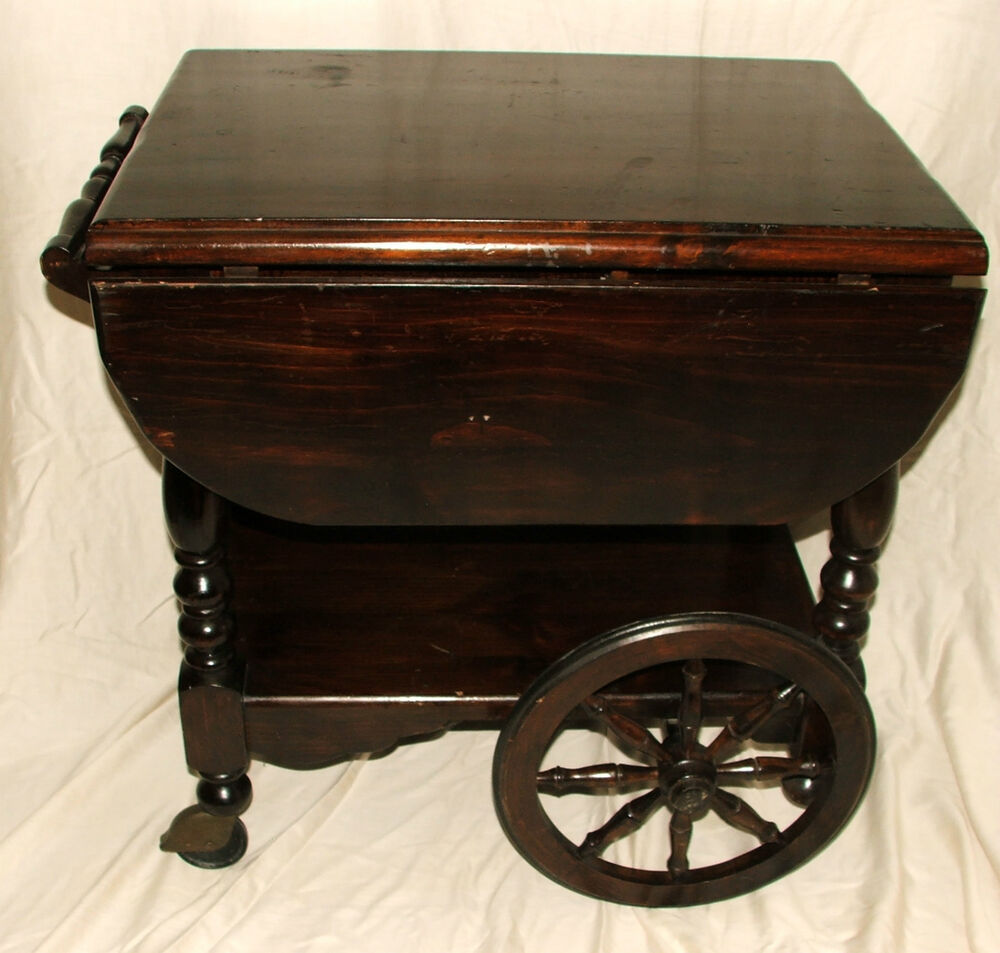 Antique wooden drop leaf wagon wheel serving tea coffee trolley roll cart table ebay Antique wheels for coffee table