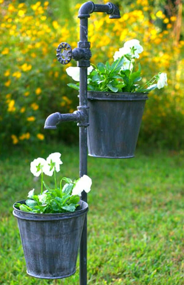 faucet and spigot knob weathered gray 2 bucket garden