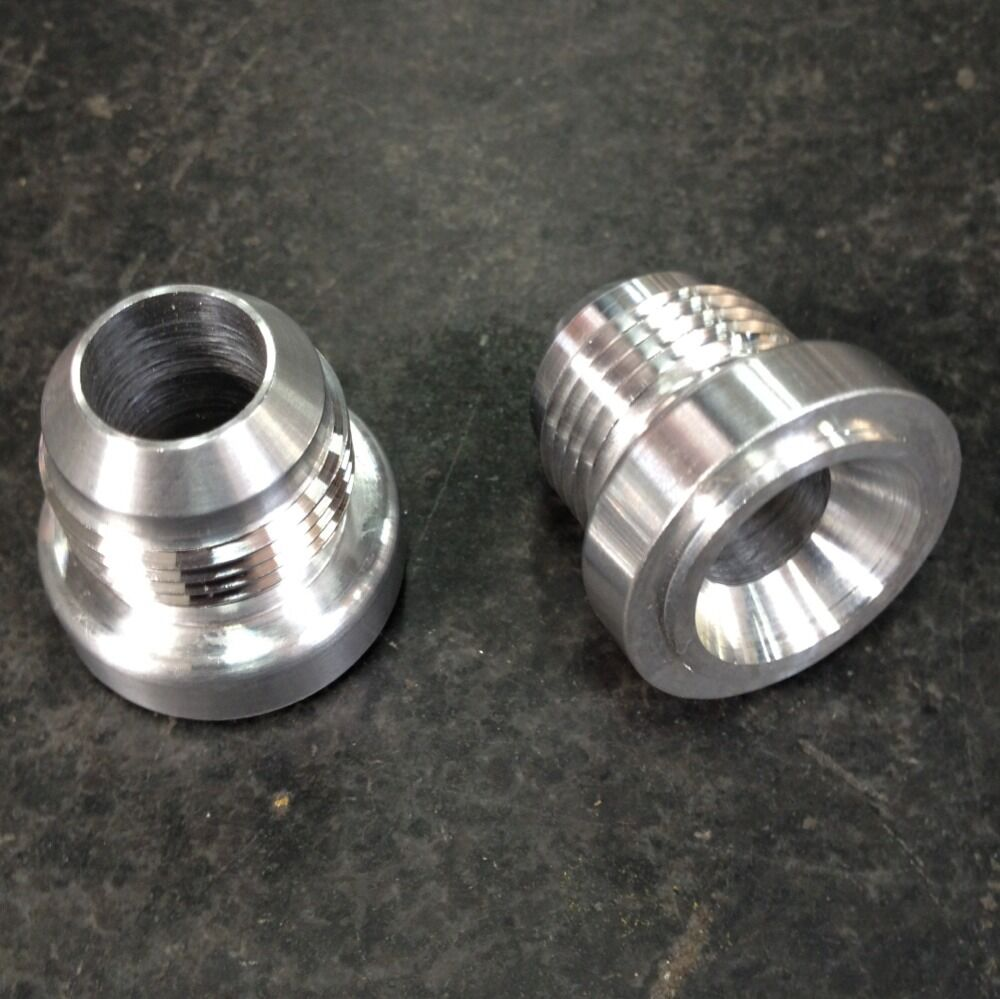 An aluminum weld on bung nut valve cover catch can