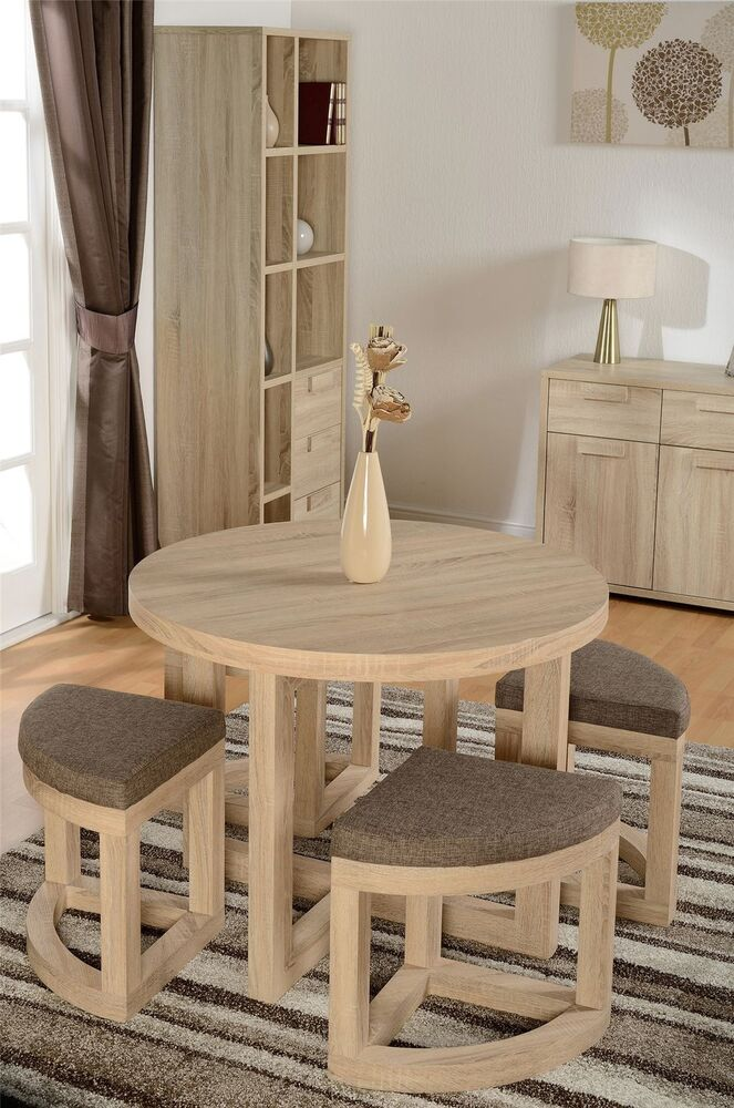 Cambourne sonoma limed oak chunky circular table 4 stools for Stowaway dining table