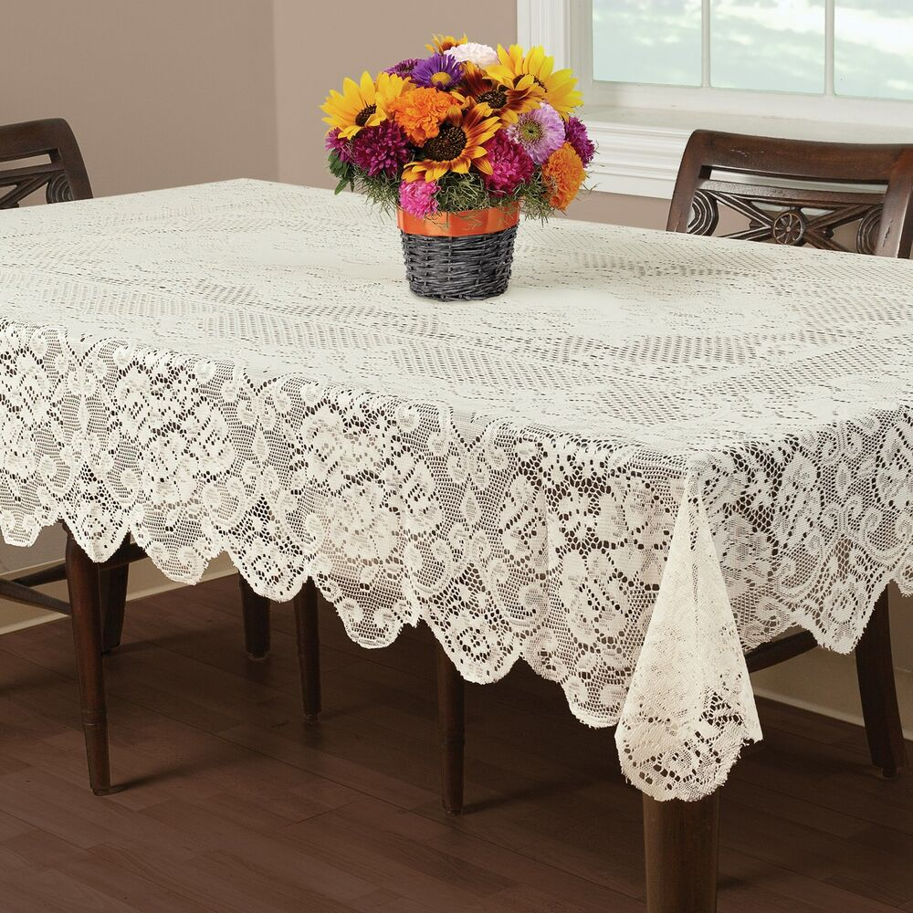 I have a lace table cloth on my dining room table with a solid tablecloth underneath and I also added a clear plastic tablecloth on top of them, it doesn't look tacky or take away from the beautiful lace design it looks really pretty; it keeps both tablecloths clean.5/5.