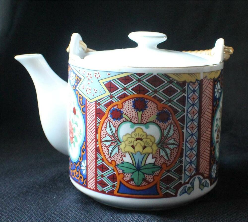 Vintage imari style tin something is