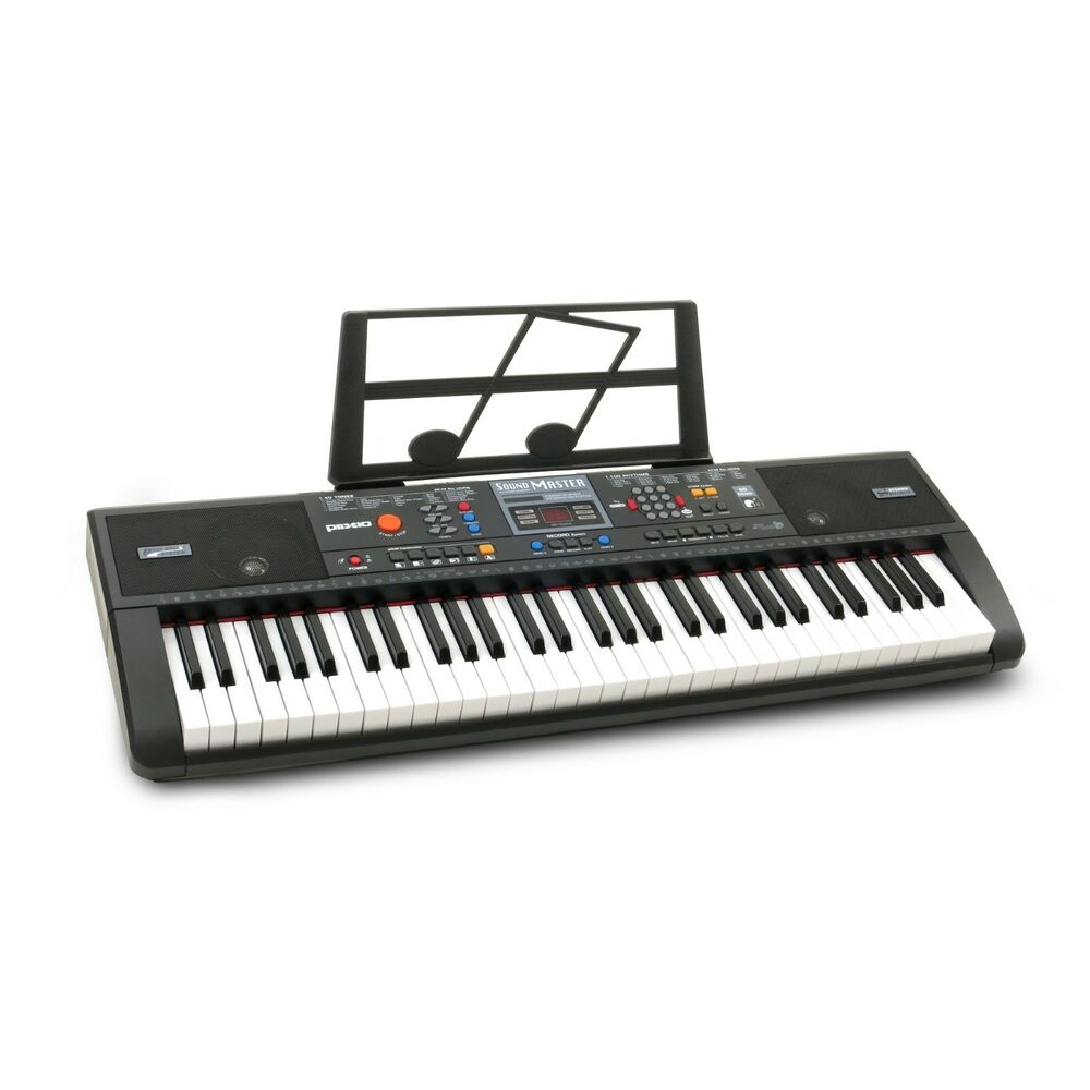 plixio 61 key electric piano keyboard with music sheet stand portable learners ebay. Black Bedroom Furniture Sets. Home Design Ideas