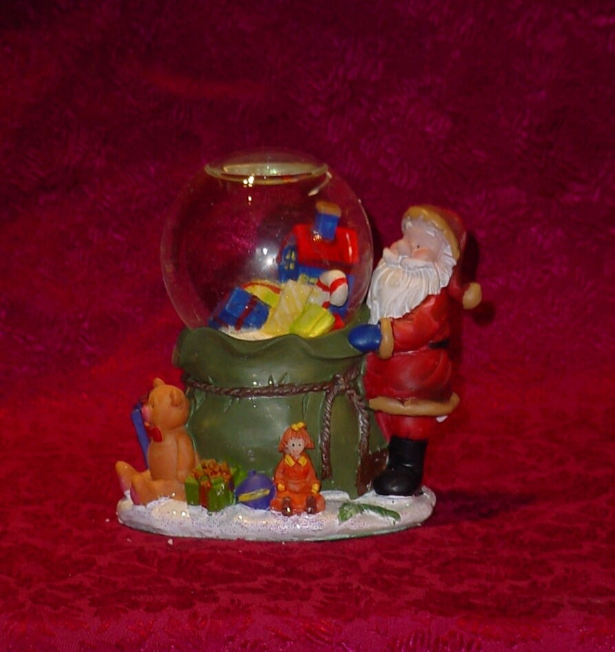 Santa claus with presents snow globe inches tall