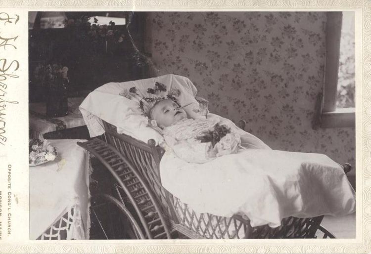 Post Mortem Photo Of Baby Girl In Carriage Surrounded By