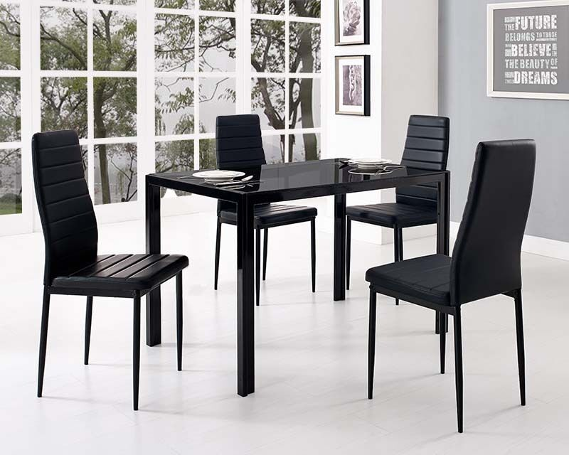 Black glass dining table and with 4 faux leather chairs for Leather kitchen table chairs