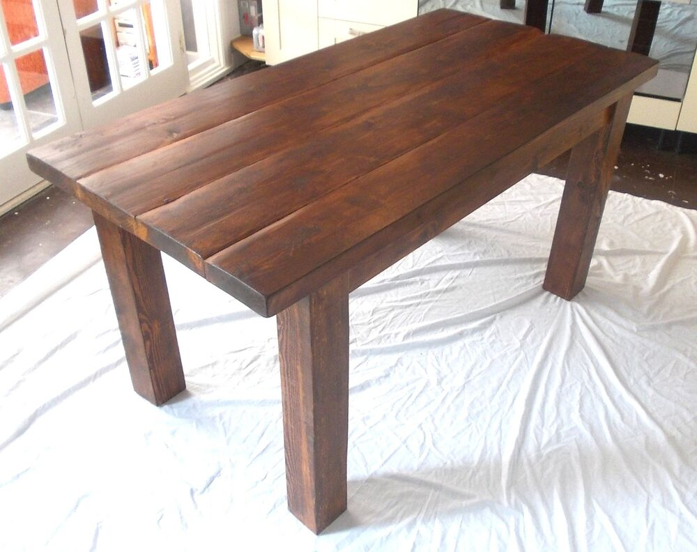 rustic solid wood plank kitchen dining table stained in dark oak