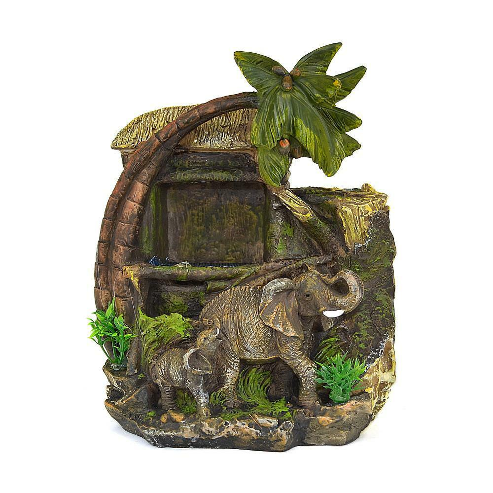 elephant baby hovel tree palm indoor tabletop water