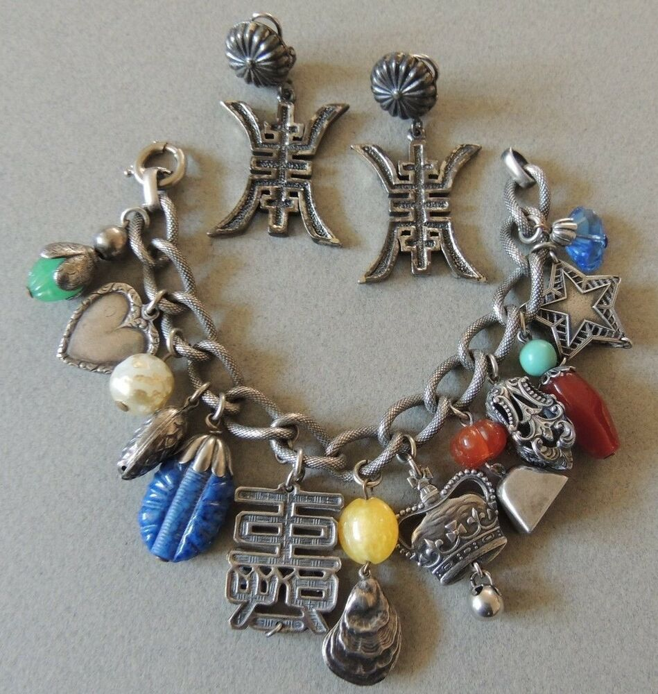 vintage silver plated ornate asian charm glass