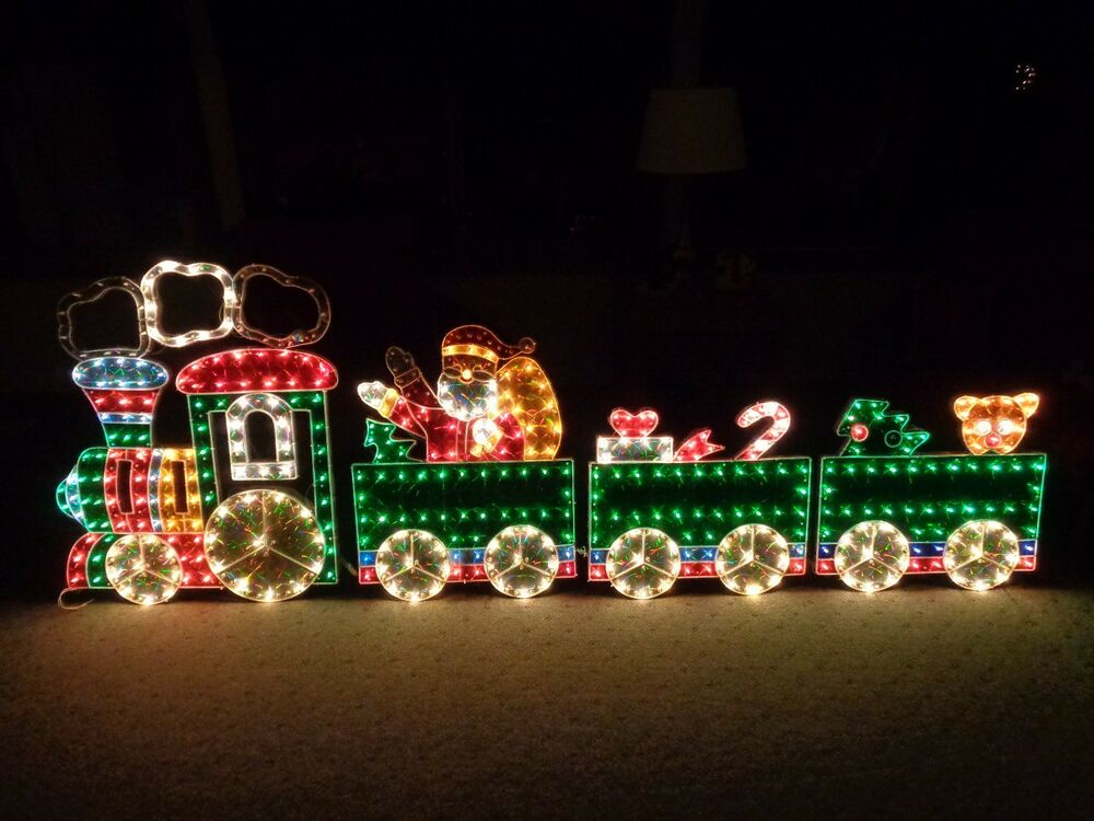 4 piece holographic lighted motion train set christmas for Holiday lawn decorations