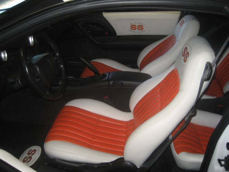 2002 35th anniversary ss camaro seat covers doorpanel inserts white w orange ebay. Black Bedroom Furniture Sets. Home Design Ideas
