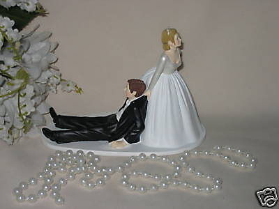 bride dragging groom wedding cake toppers wedding reception dragging groom to alter 12132
