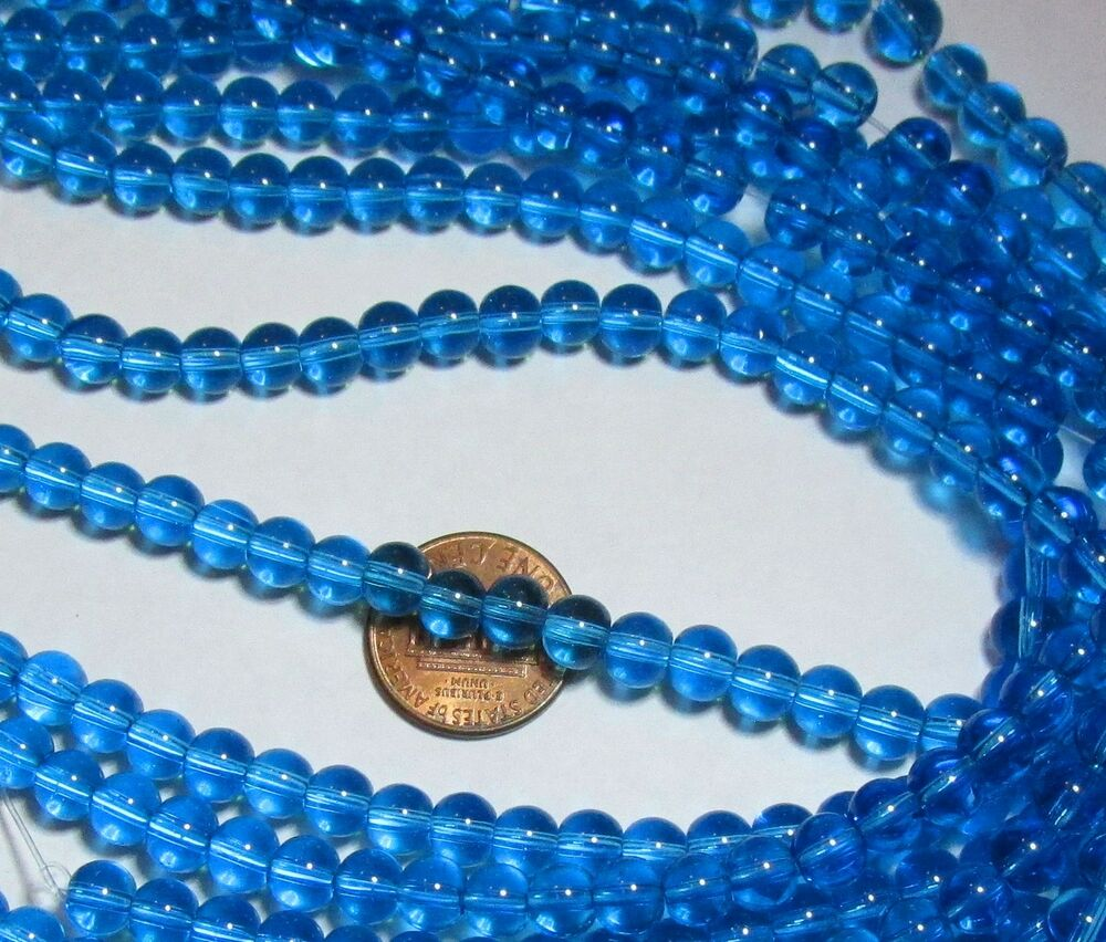 two 6mm glass bead strands 100 smooth