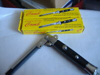 1 NEW SWITCHBLADE COMB  OPENS WITH PUSH OF THE BUTTON.FOR ALL OCCASION.