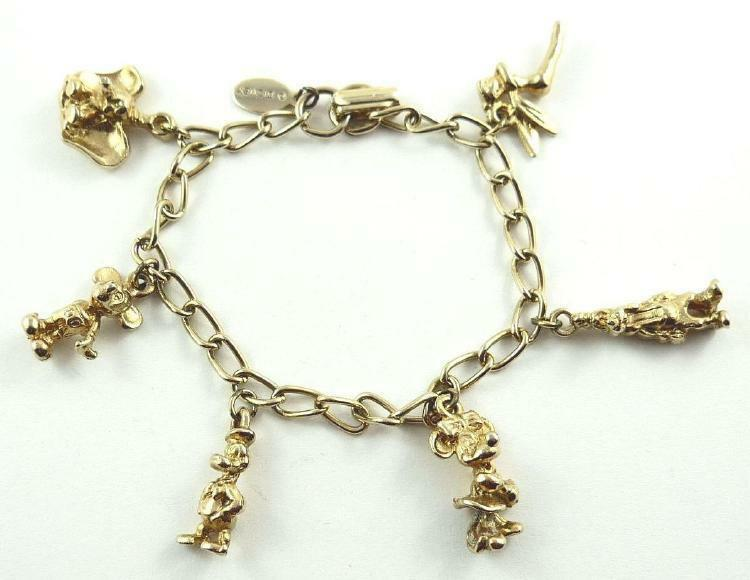 gold plated disneyland charm bracelet with 6 disney