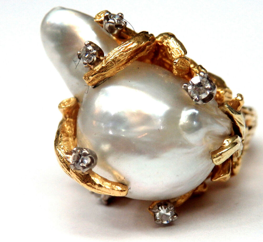 18k Yellow Gold Baroque Pearl & Diamond Coral Style. Pear Shoulder Engagement Rings. Embedded Wedding Rings. Reverse Engagement Rings. Tourmaline Engagement Rings. Prince Rings. Passion Flower Wedding Rings. Subtle Wedding Rings. Golden Leaf Engagement Rings