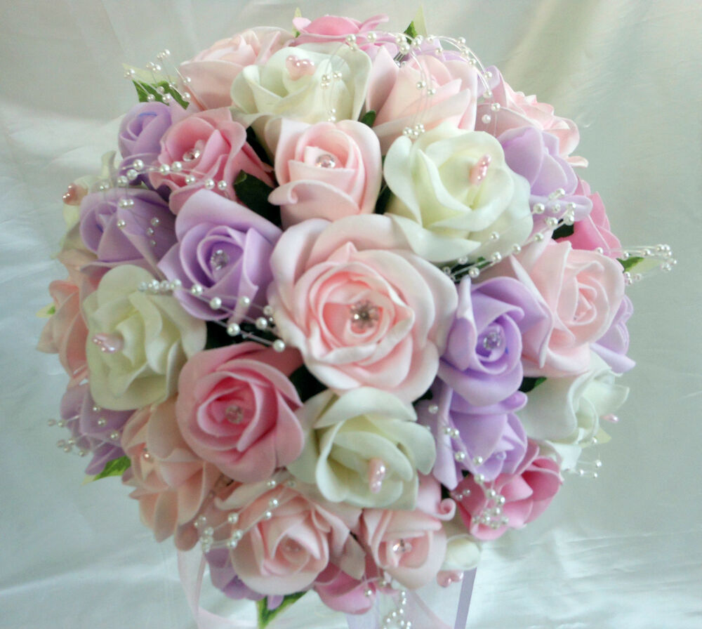 Wedding flowers bouquets sweet pea colours with pearl loop for Flower sprays for weddings