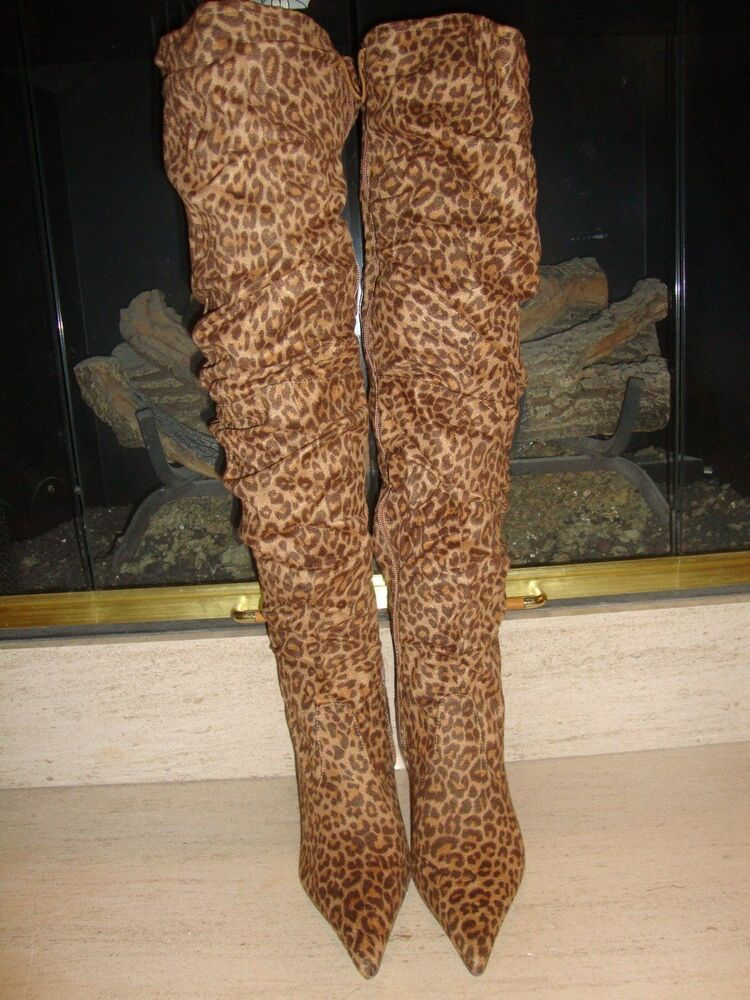 Very stylish thigh high boots featuring leopard print faux suede upper with stitched detailing, top slit with elastic back, almond shaped closed toe, semi gloss heels, and side zipper closure. Vickie hi suede leopard over the knee boots.