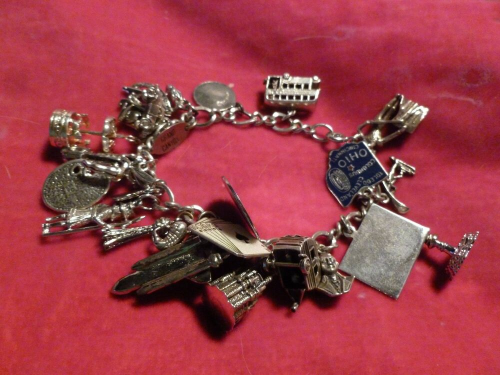 large sterling silver travel theme charm bracelet dated