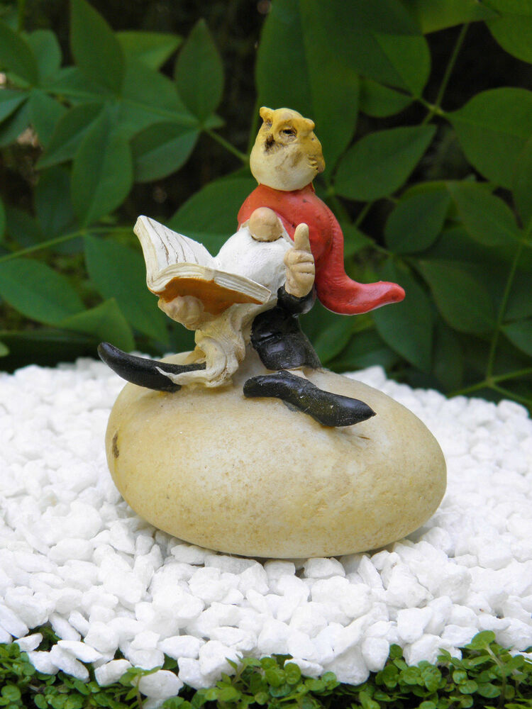 Miniature dollhouse fairy garden gnome on rock reading Reading fairy garden statue