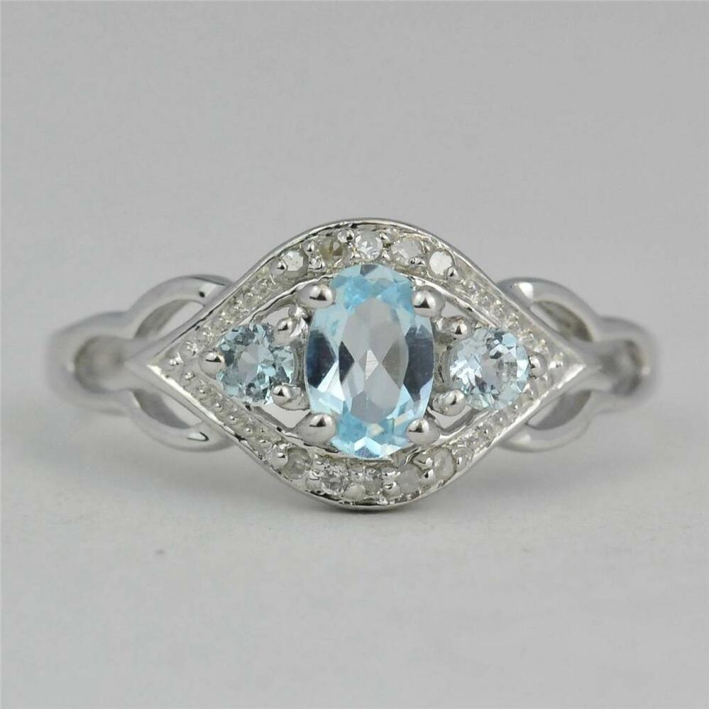 Sterling Silver Blue Topaz And Diamond Ring Ebay