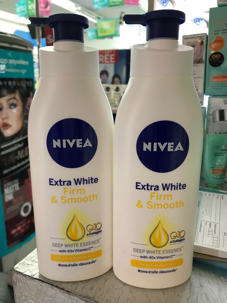 2x400ml nivea extra whitening firming body lotion q10. Black Bedroom Furniture Sets. Home Design Ideas