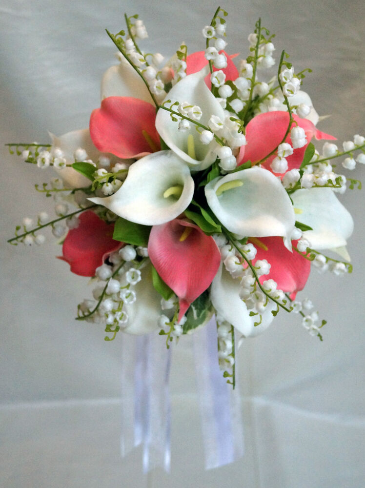 Wedding bouquet white pink calla lillies with lily of