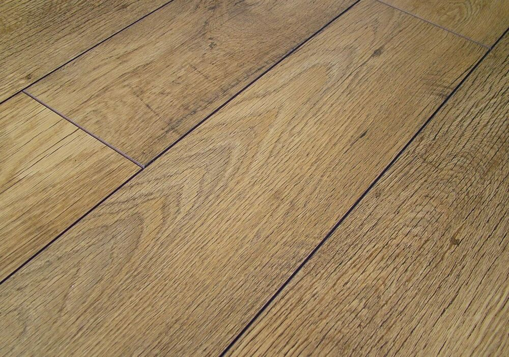 Laminate flooring pallet deal kaindl 4v groove rustic for Country home collections flooring