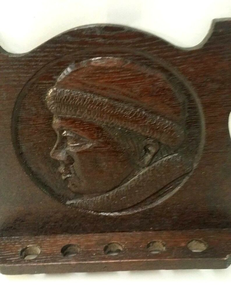 Vintage wood carved relief russian man face fir coat hat