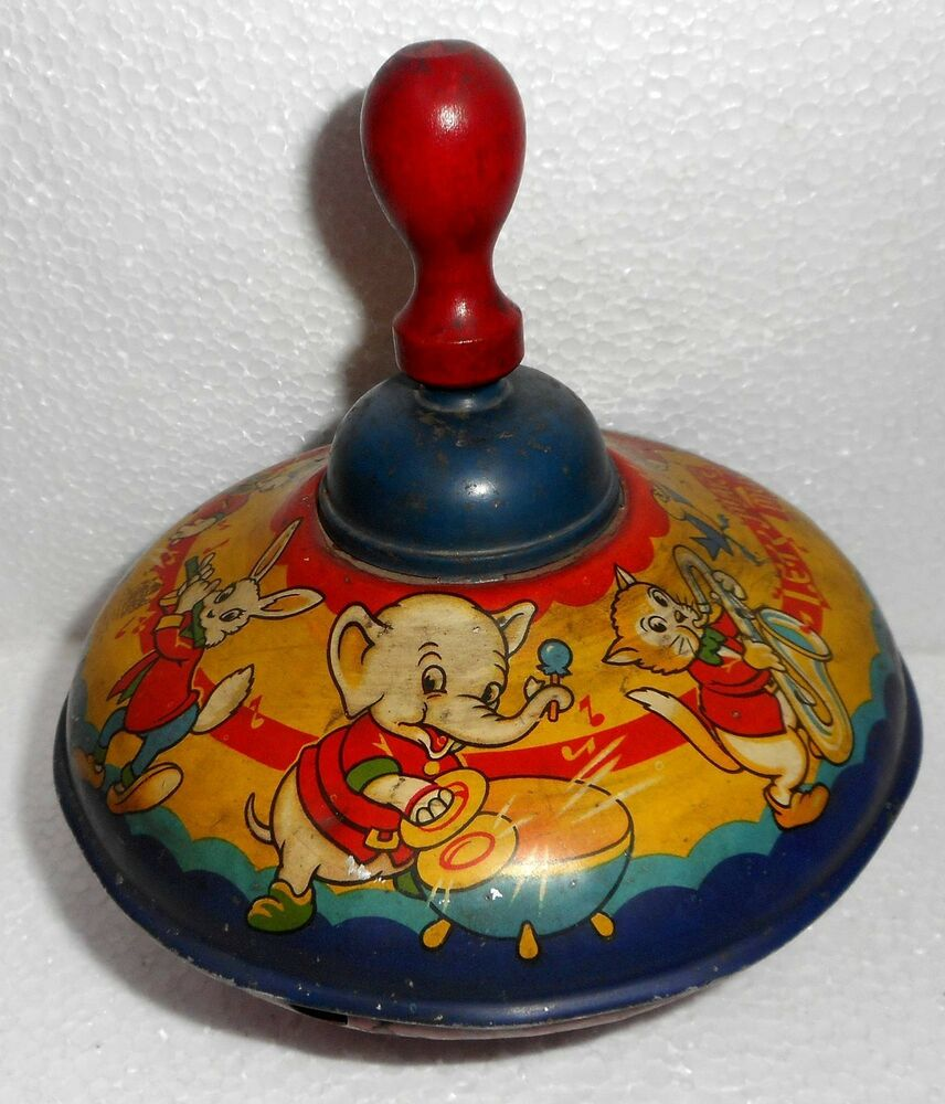 Best Antique Toys : Vintage tin toy spinning top made in england by chad