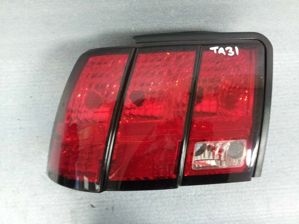 1999 2004 ford mustang driver side tail light xr33 13b505. Black Bedroom Furniture Sets. Home Design Ideas