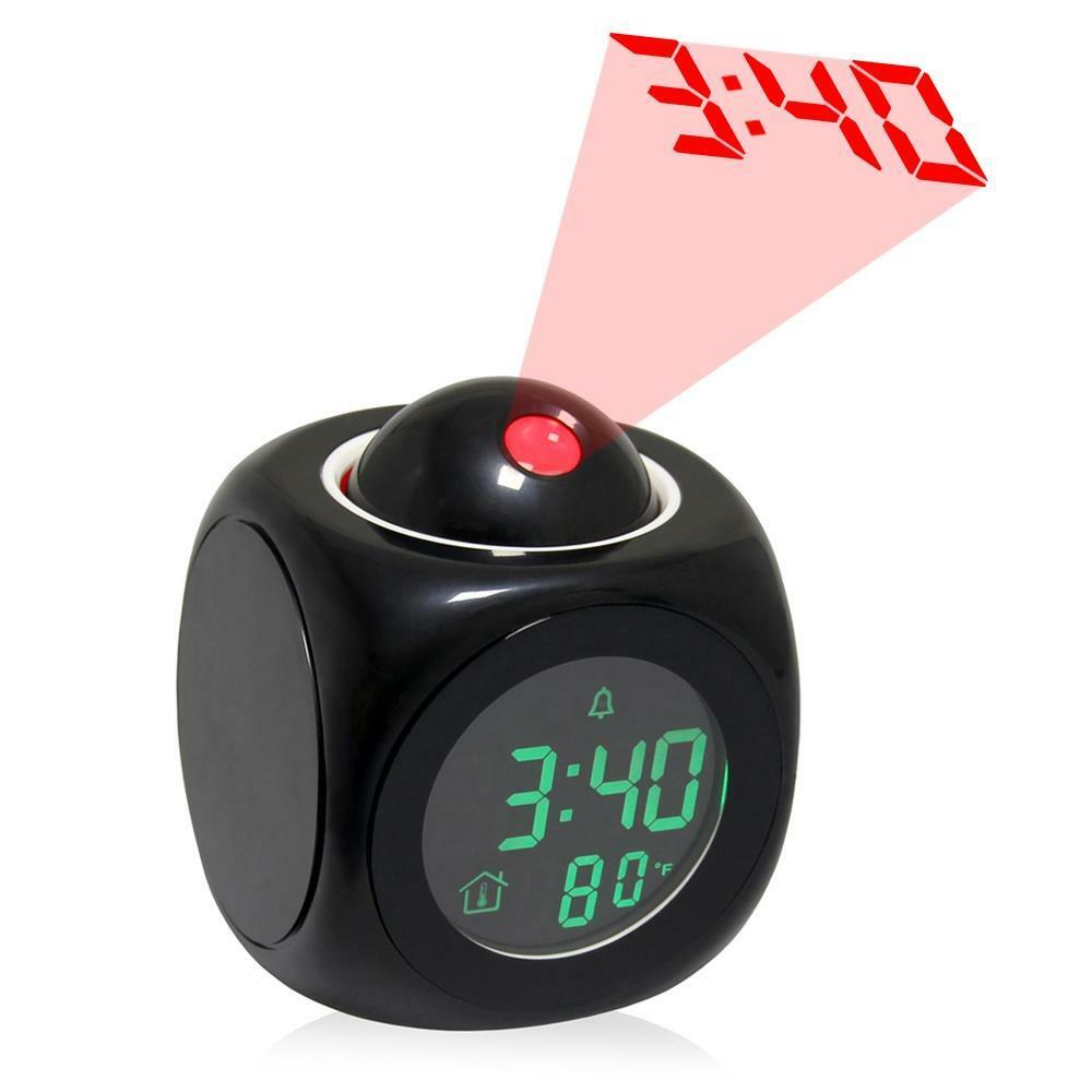 projection clock temperature Projection alarm clock projection of time and/or outdoor temperature on wall or ceiling (not adjustable) atomic self setting time and date (optional manual set.