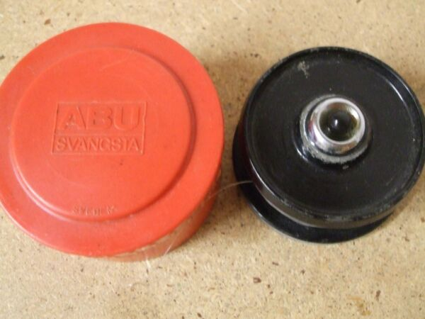 Vintage ABU SWEDEN Cardinal push button spinning reel spool, in container.
